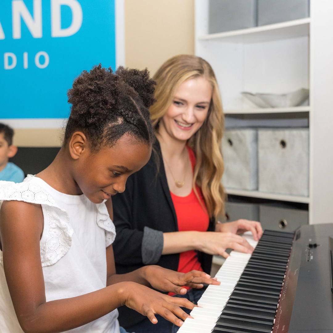 teacher and student playing piano
